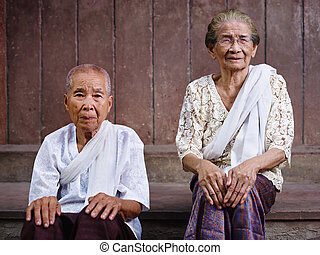 Portrait of two senior asian women looking at camera -...