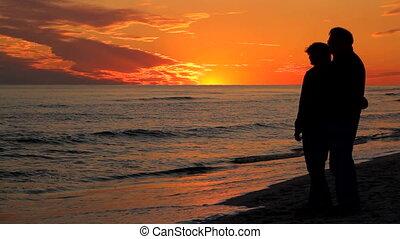 Man Woman Watching At Sunset