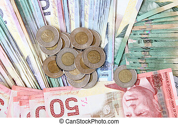 Canadian currency - Background of bank notes with coins on...