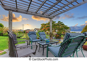 Sunset over garden gazebo with chairs. - Exterior sitting...