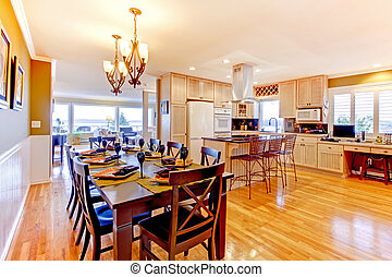 Large luxury dining room and kitchen witj shiny wood floor....