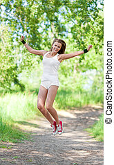 jumping woman - beautiful young jumping woman in the park on...