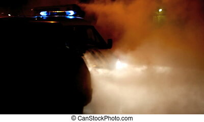 police car with flashing lights at night