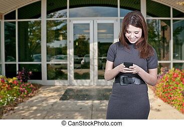 Beautiful Woman - A beautiful young woman using a cell phone...
