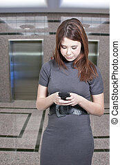 Beautiful Woman Texting - A beautiful young woman using a...