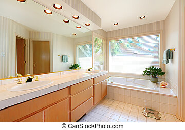 Nice bathroom with white tub and ceramic tiles.