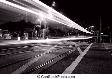 Traffic through downtown of Hong Kong at night in black and...