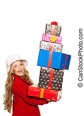 kid girl holding many gifts stacked on her hand isolated on...