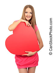 hands on heart - Beautiful young woman posing with red...