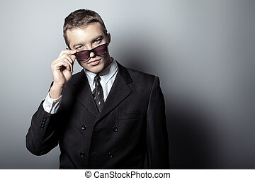 sunglasses - Portrait of a handsome young man in a suit....