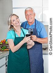 Couple Toasting Wine - Portrait of smiling couple toasting...