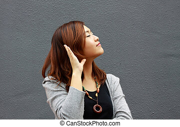 Asian woman hearing voice