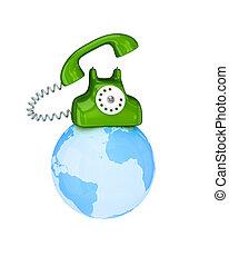Green retro telephone on a globe