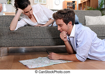 Couple plotting route on map
