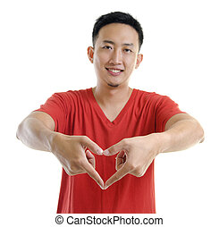 Love sign - Asian young man showing love hand sign