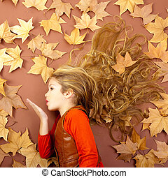 autumn girl on dried leaves blowing wind lips - autumn fall...