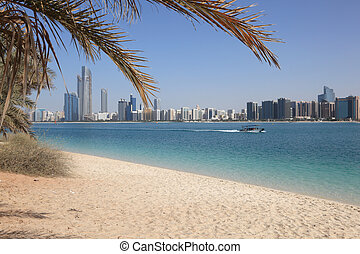 Beach and the skyline of Abu Dhabi, United Arab Emirates