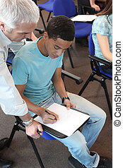 Young man in professional training with teacher