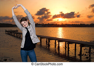 Woman at Sunrise - Beautiful woman stretching in a morning...