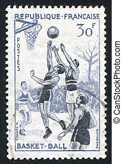 basketball players - FRANCE - CIRCA 1956: stamp printed by...