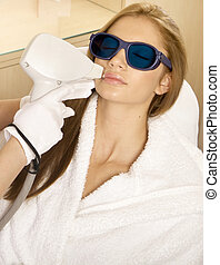 Laser hair removal in professional beauty studio. beauty...