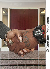 Black Man and woman shaking hands