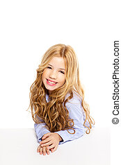 blond kid little girl portrait smiling on a desk in white