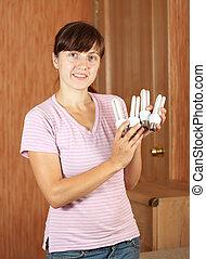 Girl holding  light bulbs