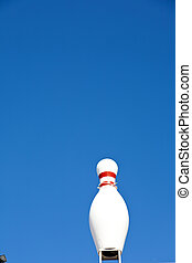 bowling pin in blue sky as symbol for a bowling place