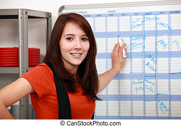 factory worker filling the schedule