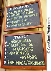 spanish menu - foreground of a poster of the menu in a...