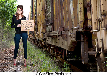 Woman Holding a Sign - A beautiful young woman holding up a...