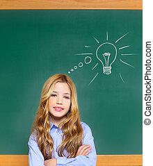 kid student girl on green school blackboard and drawn light...