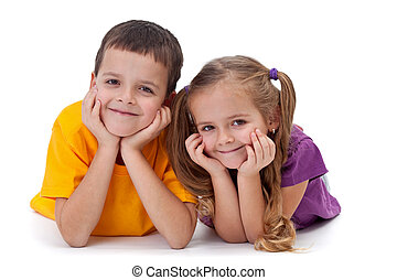 Happy kids - boy and girl - Beautiful happy kids laying on...