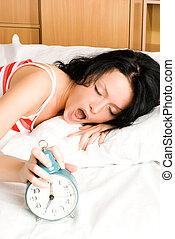 beautiful woman wakes up - beautiful young brunette woman...