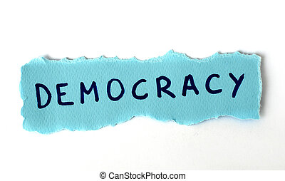 The word Democracy on blue paper background