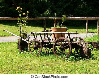 Decorative barrow - Old barrow with the flower boxe on green...