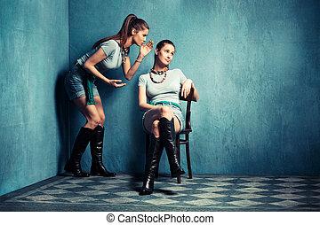 gossip - multiplied  women in old grungy room
