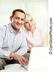 Happy seniors - Portrait of mature man and his wife with...