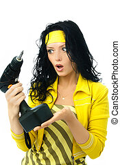 surprised young woman with a drill - beautiful young...
