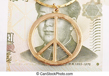peace sign - A peace sign as jewel on cash