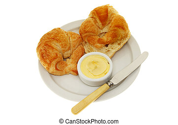 Croissants butter knife - Two croissants, butter and a knife...