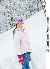 winter girl throwing snowball - Smiling happy girl having...