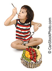 Kid eating fruit cake