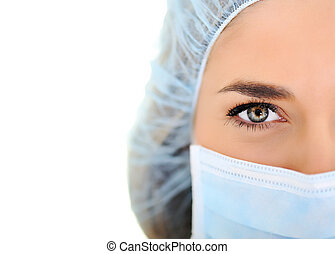 Female doctor wearing surgical cap and mask