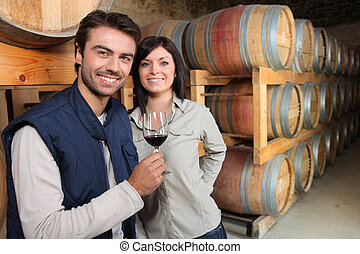 Couple in a wine cellar