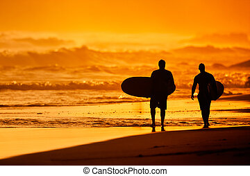 Sunset Surfers - Silhouettes of Surfers on the Beach at...