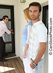 Couple visiting a property with an estate agent