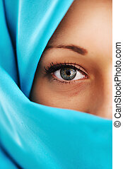Young woman with blue scarf