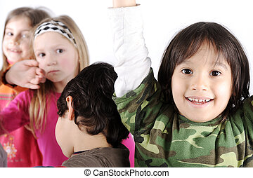 Group of playful children in studio